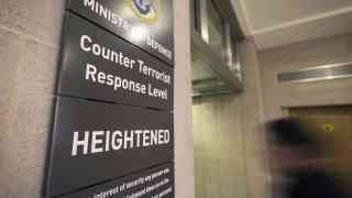 Terror threat lowered as police question suspects