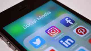 May: social media giants need to do more to tackle terrorism